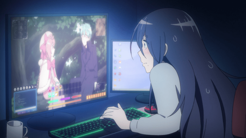 A woman with long dark hair, wearing a sweatsuit, hunkers over a computer desk. On the main computer monitor is the image of a girl in a pink cloak and a boy in a purple suit. The bottom of the screen has text and color bars, implying this is a video game.