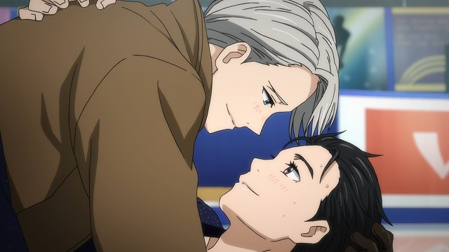 A close shot of Yuri and Victor smiling tenderly at one another; Victor is lying on top of Yuri on the ice