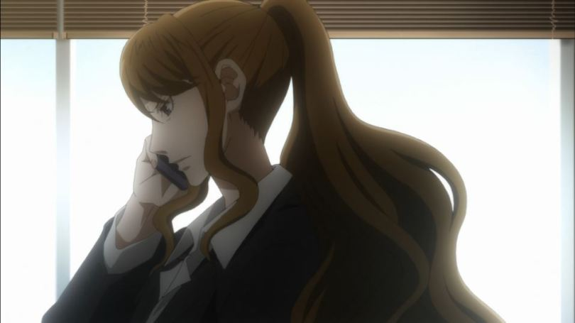 Close up of Reiko talking on the phone