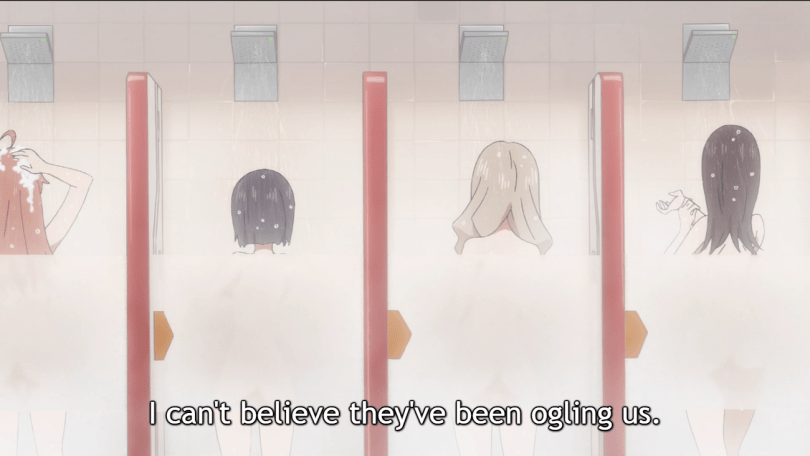 """A shot of four teen girls in shower stalls, their backs to the camera. Subtitles read """"I can't believe they've been ogling us."""""""