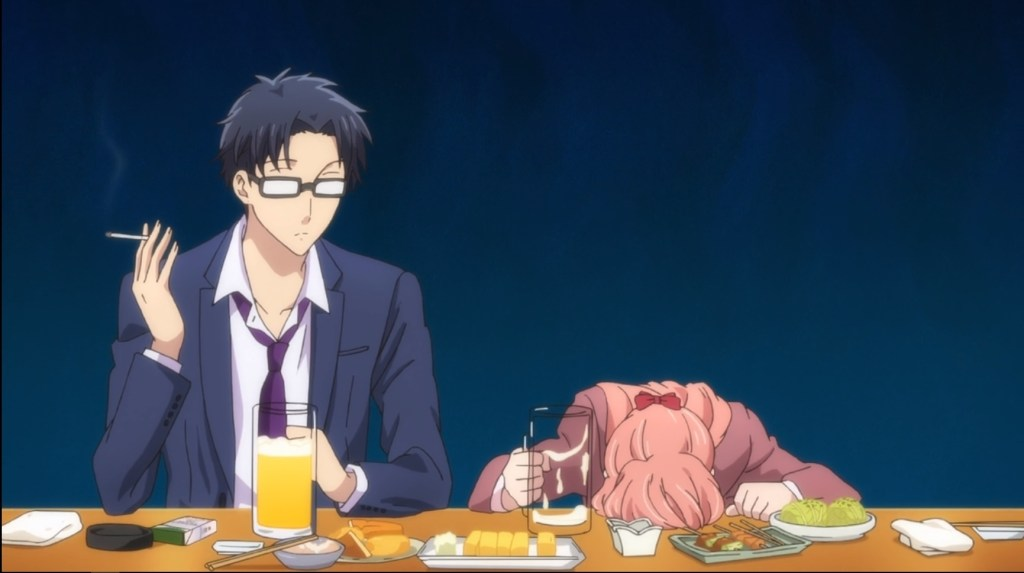 A man and a woman sit at a table covered in food and two beer mugs. The man is holding a cigarette; the woman has her head down on the table.