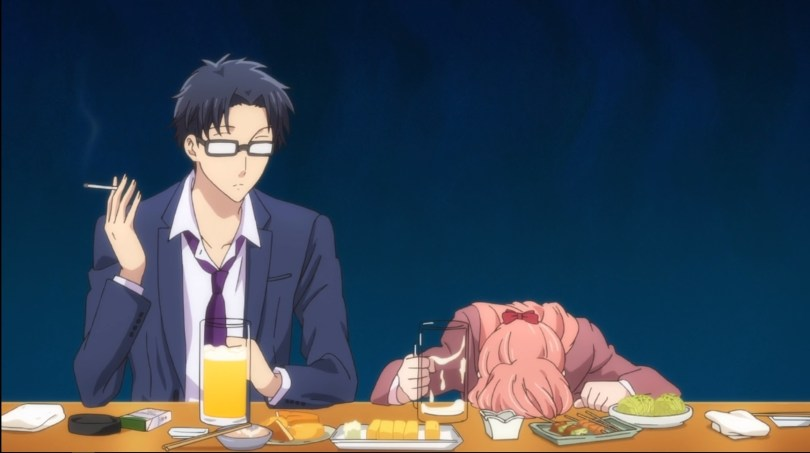 A man in glasses and a business suit sit at a table, holding a beer and a cigarette. He looks at a woman in a business suit who has her head on the table, an empty beer mug in one hand.