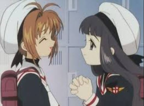 Tomoyo looking at Sakura with hands clasped