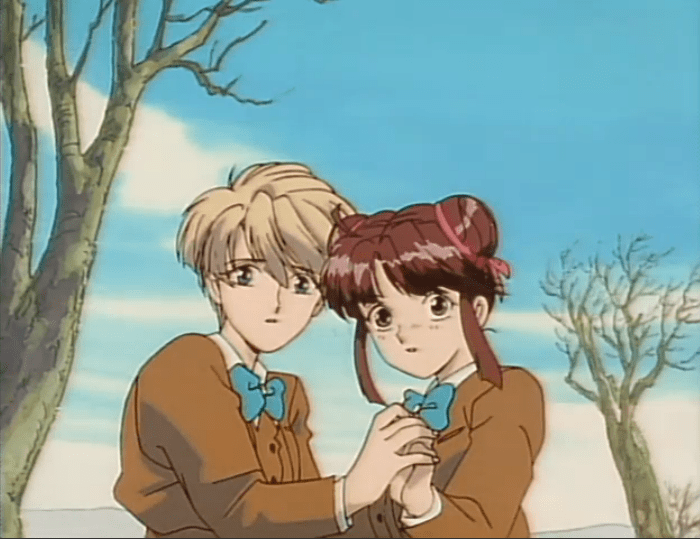 Two teen girls in school uniforms, a blonde (Yui) and a brunette (Miaka), huddle together and hold hands, looking fearful.