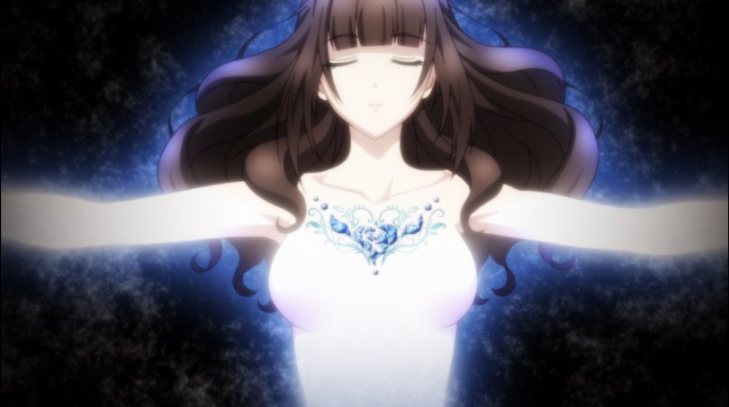 A young woman with long, dark hair (Cardia) stands with her arms outspread, eyes closes, a glowing necklace of blue rocks embedded in her collarbone.