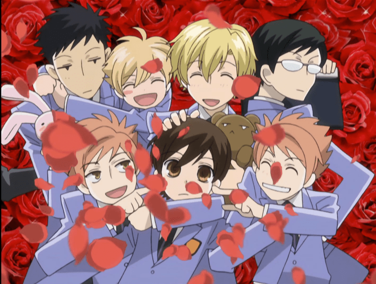 A group shot of the entire Ouran Host Club, with rose petals flowing in front of them.