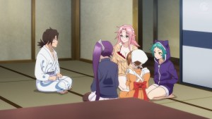 A young man in a yukata sits facing a group of four girls and women.