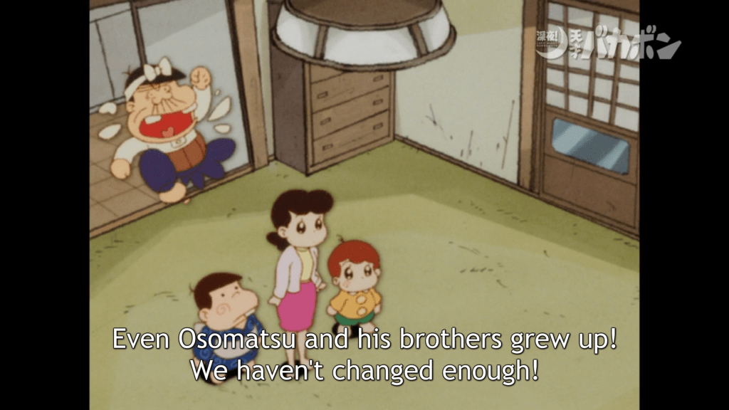 "A woman and two boys stand in the center of a traditional Japanese-style tatami room. A middle-aged man jumps up being them, looking upset, and shouts ""Even Osomatsu and his brothers grew up! We haven't changed enough!"""