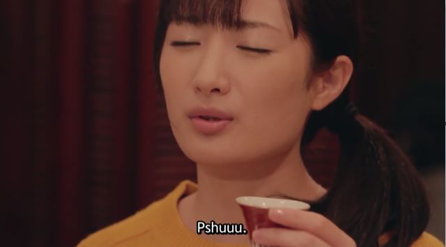 live action Wakako closing her eyes in satisfaction. caption: Pshuuu.