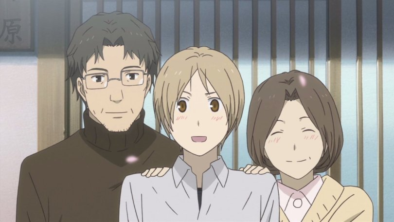 Natsume blushes while his two guardians stand on either side of him, smiling.