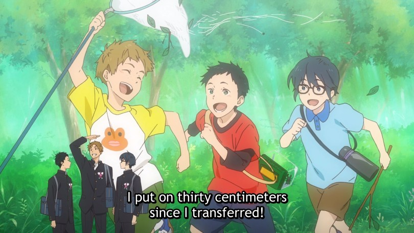 "Three young boys running through the forest and laughing takes up most of the frame. In the foreground are three similar-looking people, now teen boys, wearing school uniforms. Subtitles read ""I put on thirty centimeters since I transferred!"""