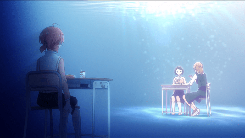 Yuu at her desk, metaphorically underwater and miles away from her friends