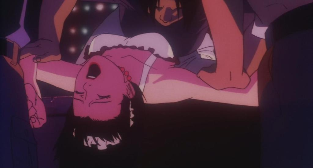 Mima screaming as men pin her down and simulate rape