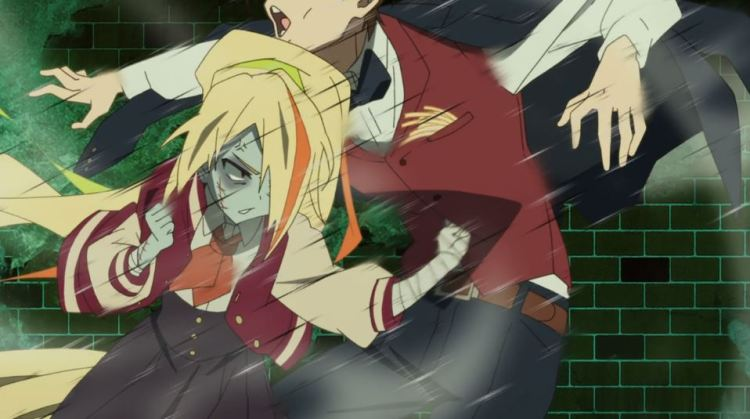 A teenage zombie girl with long blonde hair socking her suit-wearing manager in the gut