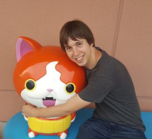 Photo of Callum hugging a cat anime character model