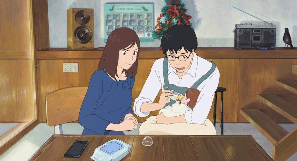 Screenshot from Mirai: a couple sit together at the dining table in their home, the mother watching intently as the father, who is wearing an apron, tries to bottle feed their new daughter.