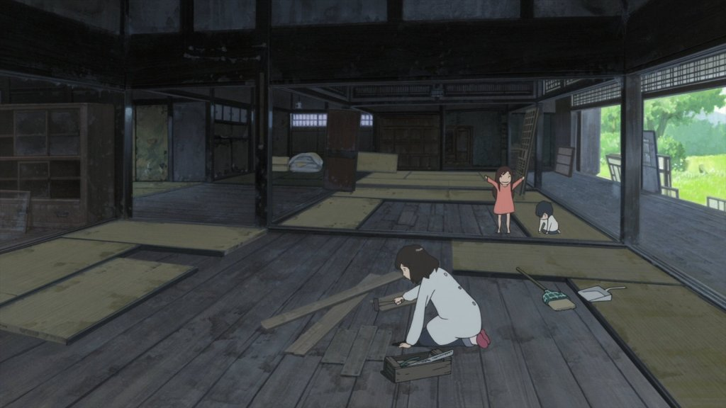 Screenshot from Wolf Children. The mother and her two young children work on repairing the floors in their old, dirty house, an enormous job for just one adult.