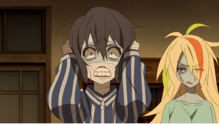 A zombie girl clasping her head and gritting her teeth while another in the background gives her the side eye
