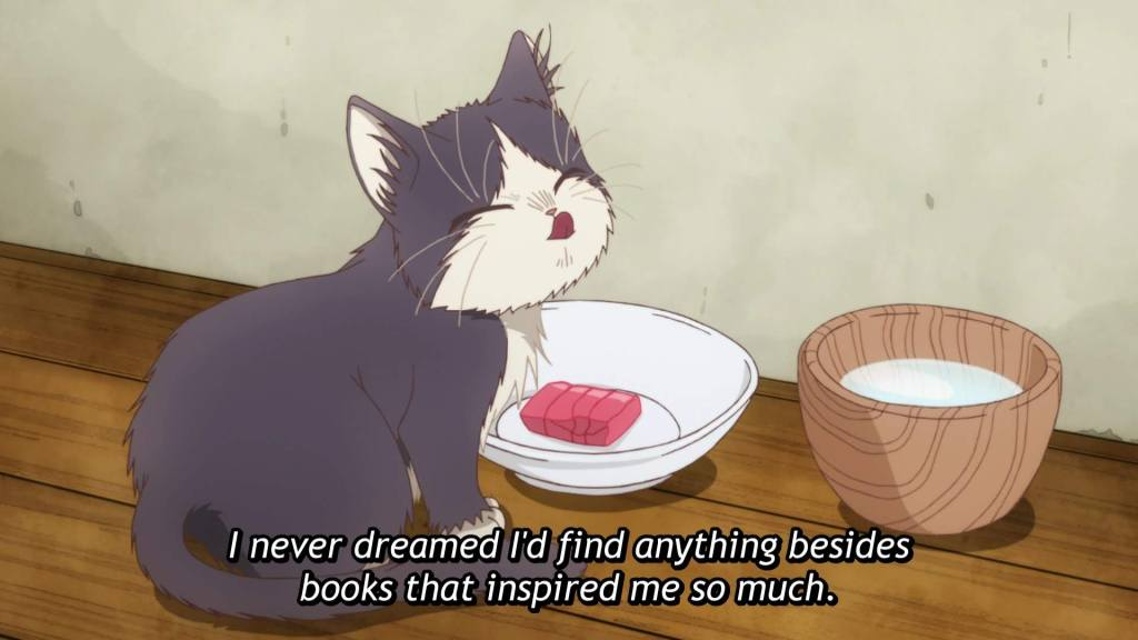 "A gray-and-white cat licks its lips while standing next to a saucer with sashimi in it. Subtitles read ""I never dreamed I'd find anything besides books that inspired me so much."""
