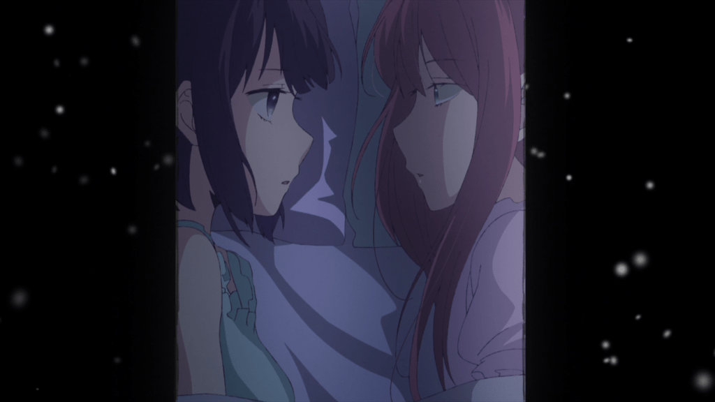 A narrow-framed shot of Hanabi and Sanae looking at each other in bed. The shot is framed by black with white snowfall drifting through it