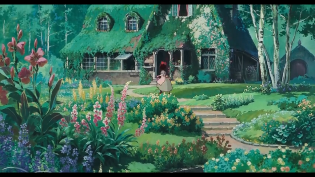 Kiki running up to a moss-covered house surrounded by a garden