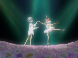 Princess Tutu holding Mytho by the hand under a spotlight in a field of flowers