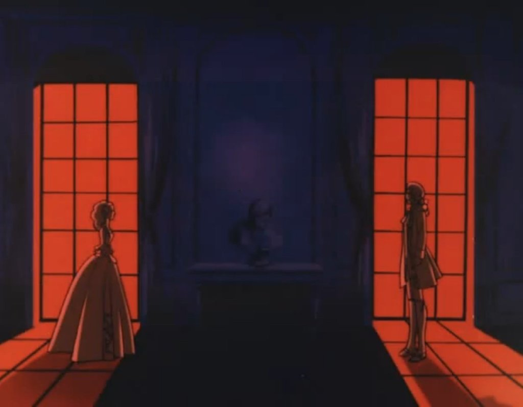 Two silhouetted figures illuminated by windows full of red light