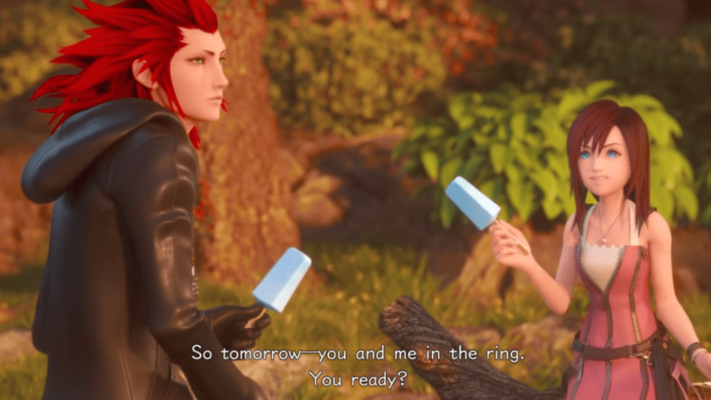"Kairi and Axel sit next to each other eating ice cream bars. Kairi says ""So, you and me in the ring. You ready?"""