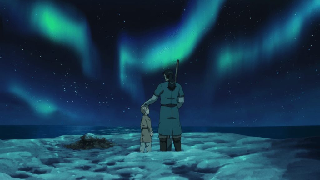 Thors putting a hand on his son's head as they stand under the Aurora Borealis