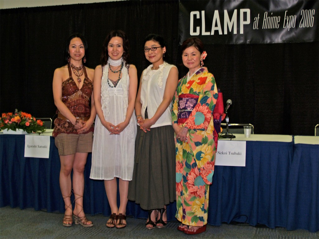 Four women from CLAMP stand in a row at Anime Expo 2006
