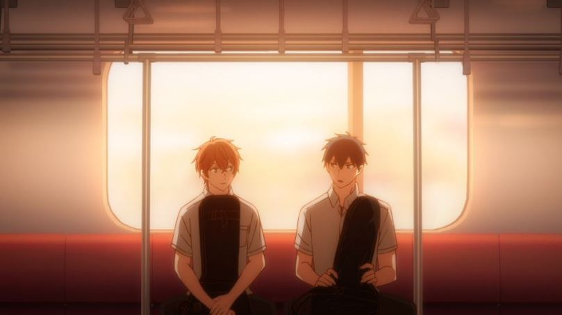 the two boys from Given sitting togehter on the bus at sunset