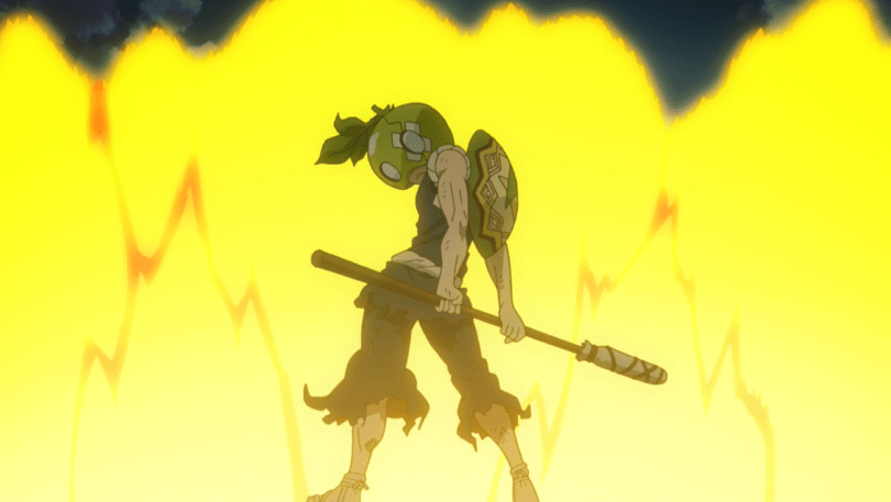 a spear-wielding warrior in a watermelon mask standing in front of an explosion
