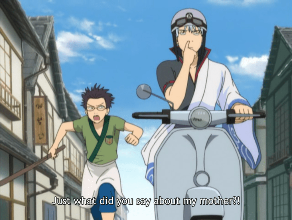 Shinpachi chasing a bored Gintoki on a scooter. subtitle: Just what did you say about my mother?