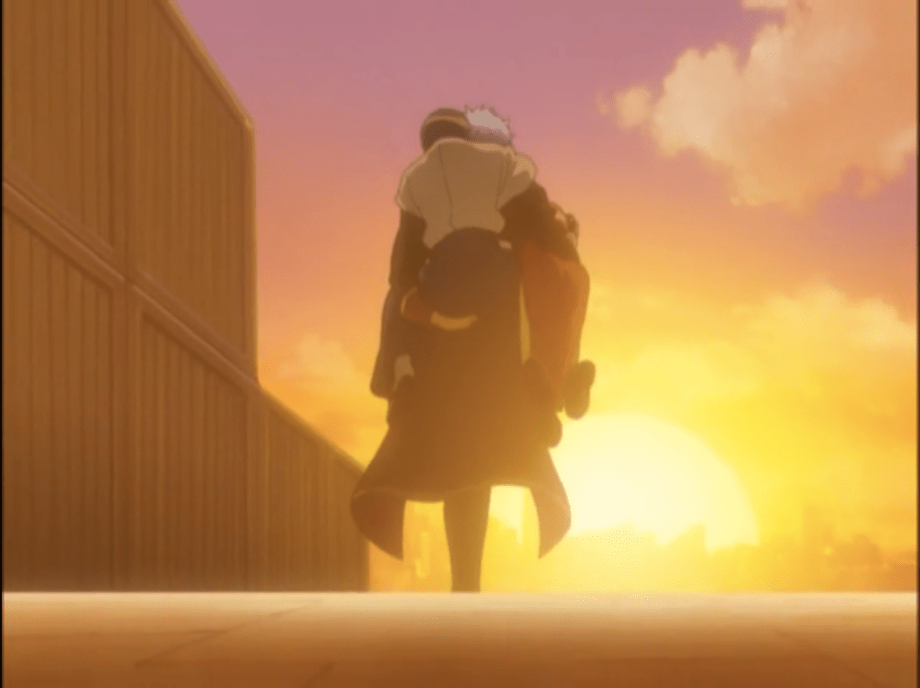 Gin walking into the sunset with someone on his back