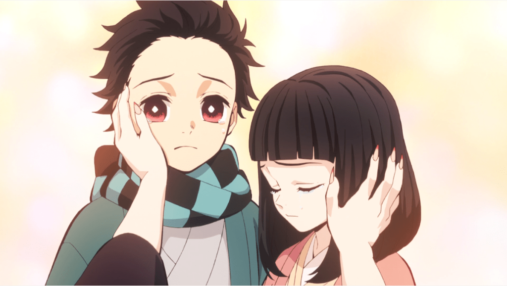 Comforting hands touching young Tanjiro and Nezuko's faces