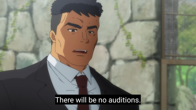 A man in a black suit Subtitle: There will be no auditions