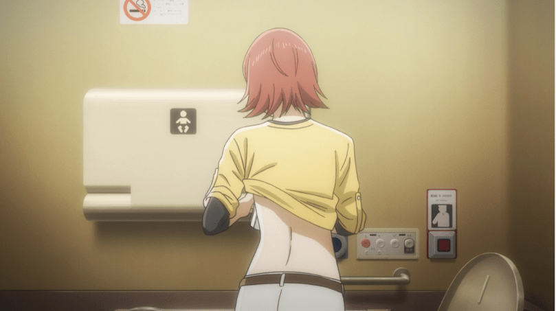 Inokuma lifting her shirt in a bathroom to pump milk