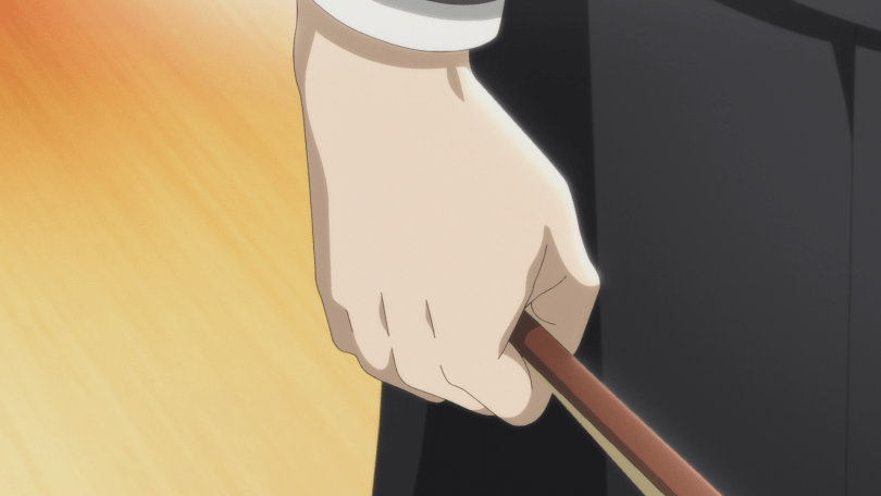 closeup of Shinji's hand gripping a violin bow by its hair