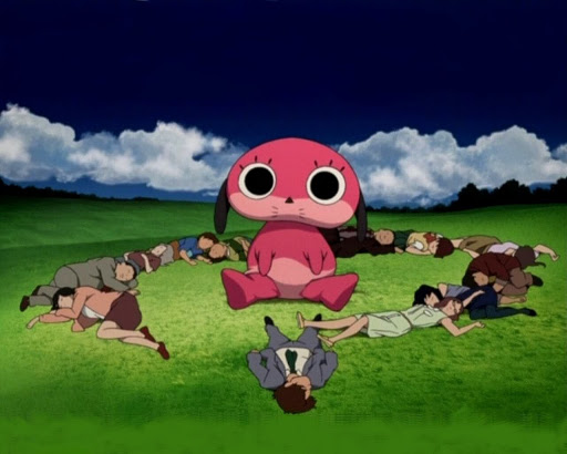 the cast of Paranoia Agent lying in the grass around the giant mascot Maromi