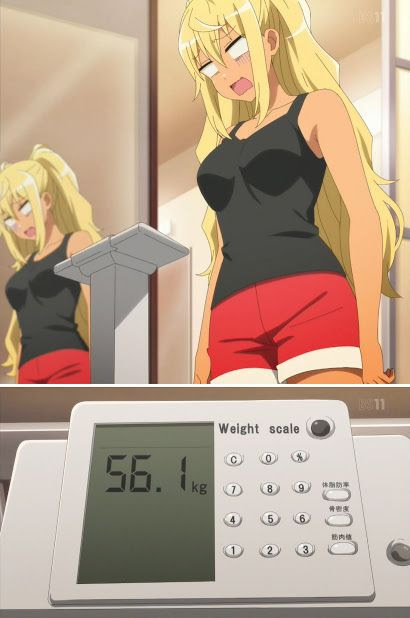 Hibiki looking at an image of her weight, 56.1 kg, in horror