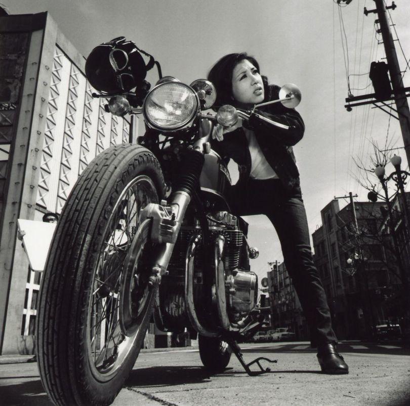 Wada Akiko on a motorcycle