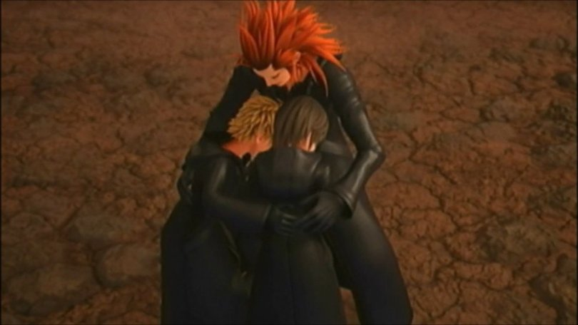 Axel, Roxas, and Xion embracing