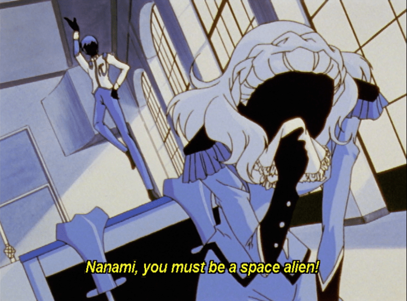 Nanami imagining herself being mocked by a classmate. subtitle: Nanami, you must be a space alien.