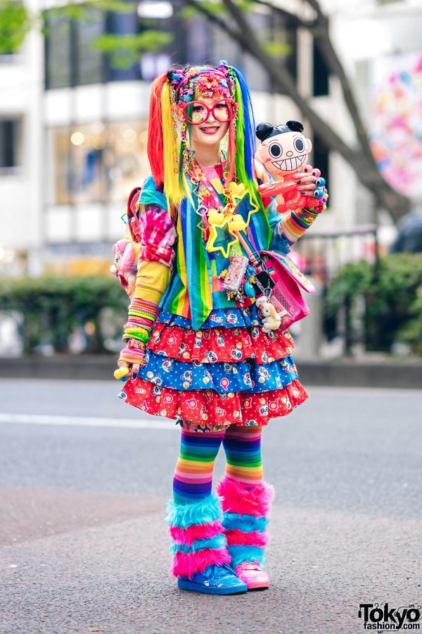 A woman with bright rainbow clothes and hair