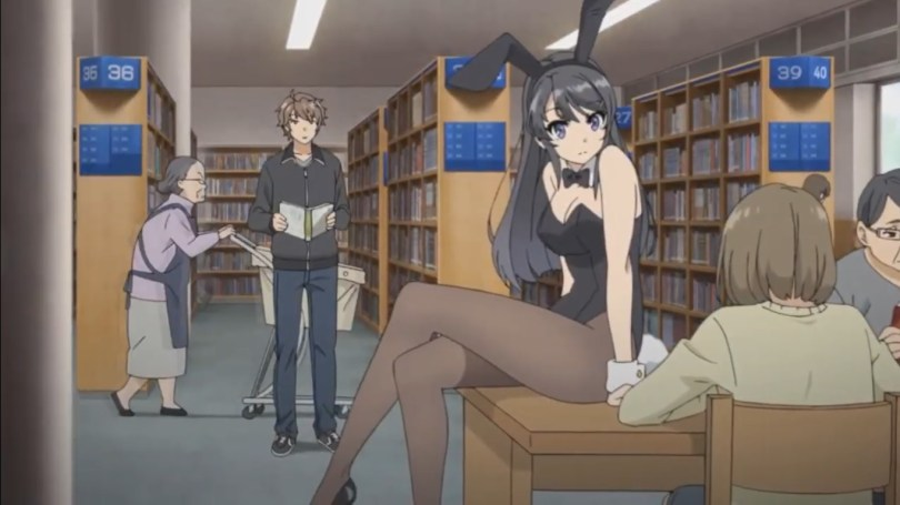 A young woman in a Playboy bunny suit sitting on a table in a library