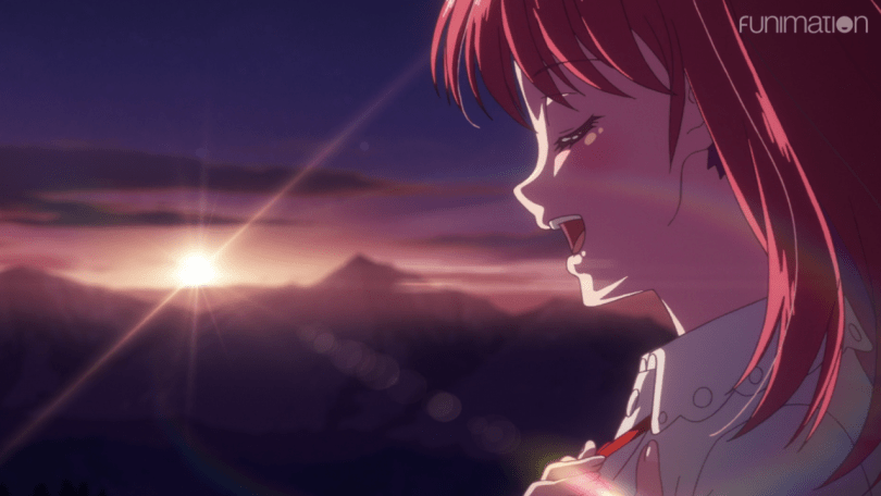 close shot of a redhead girl singing with the sunrise in the background
