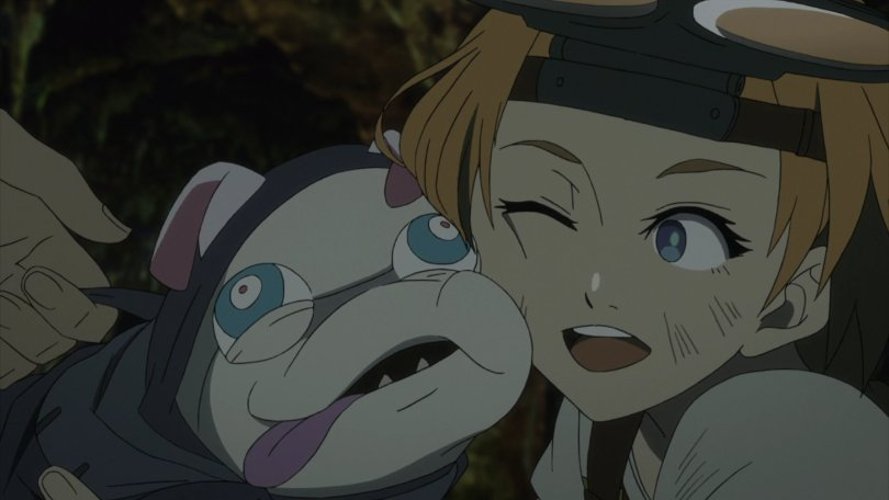 a redheaded young woman squishing a googly eyed, puggish monster pet to her face in a hug