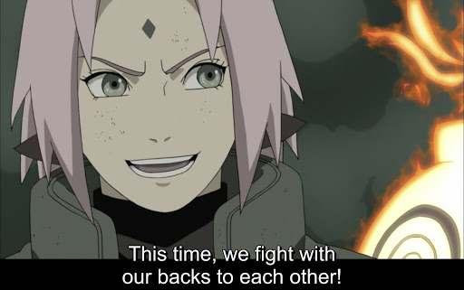 close-up of older Sakura. subtitle: This time, we fight with our backs to each other!