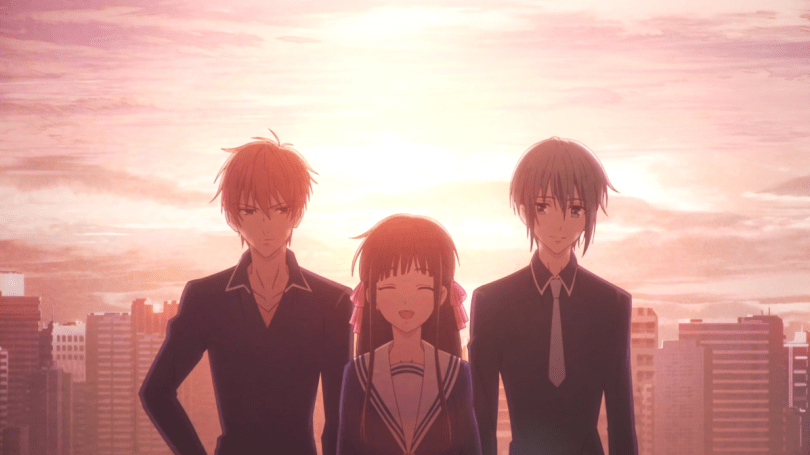 Tohru, Yuki, and Kyo from Fruits Basket smiling in front of the sunset