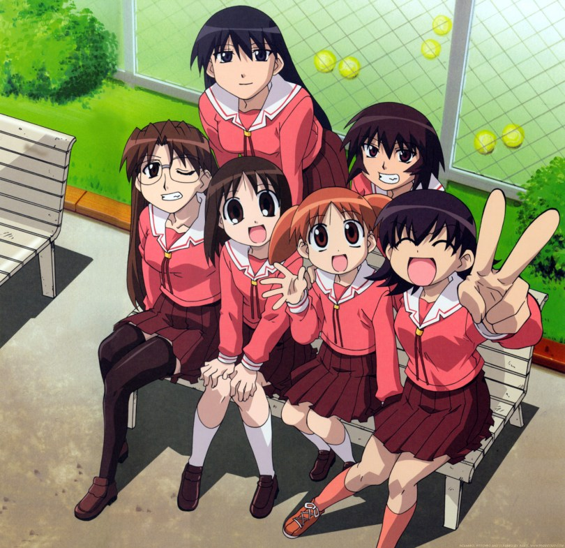 The cast of Azumanga Daioh sitting bunched together on a bench, smiling toward the camera